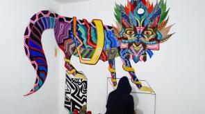 pintando mural coyo